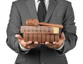 4432885 / lawyer with gavel judge and books