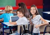 4468303 / Schoolchildren With Digital Tablet Sitting In Classroom