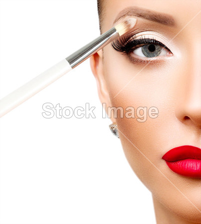 Applying eye makeup