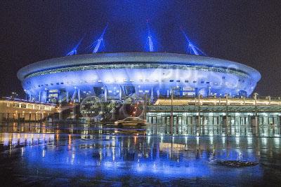 4174049 / Стадион `Зенит-Арена`. Футбольный стадион `Зенит-Арена` на Крестовском острове к чемпионату мира по футболу 2018 года. Вечерняя подсветка.