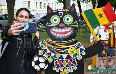 4397864 / День петербургского кота. День петербургского кота. Фигуры котов, символизирующие сборные команд, принимающие участие в Чемпионате мира по футболу FIFA-2018.