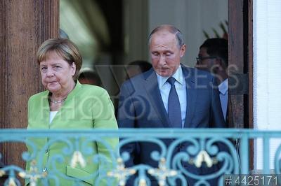 4425171 / Меркель и Путин. Встреча президента РФ и канцлера Германии. Канцлер Германии Ангела Меркель и президент России Владимир Путин.