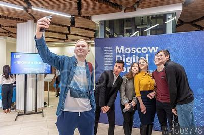 4508778 / Селфи. Московский цифровой форум 2019. Молодые люди делают селфи.
