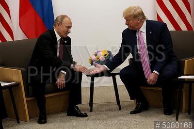 5080168 / Путин и Трамп. Саммит `Группы двадцати` (G20). Президент России Владимир Путин и президент США Дональд Трамп (справа).