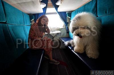5860066 / Пассажиры поезда. Женщина с собакой в купе поезда.