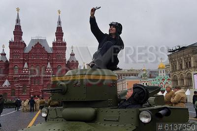6137350 / Танк Т-37А. Торжественный марш, посвященный 78-й годовщине военного парада 7 ноября 1941 года на Красной площади. Девушка делает сэлфи, сидя на танке Т-37А.